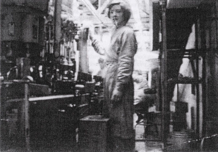 Miss Winifred Delahaye and bottling plant